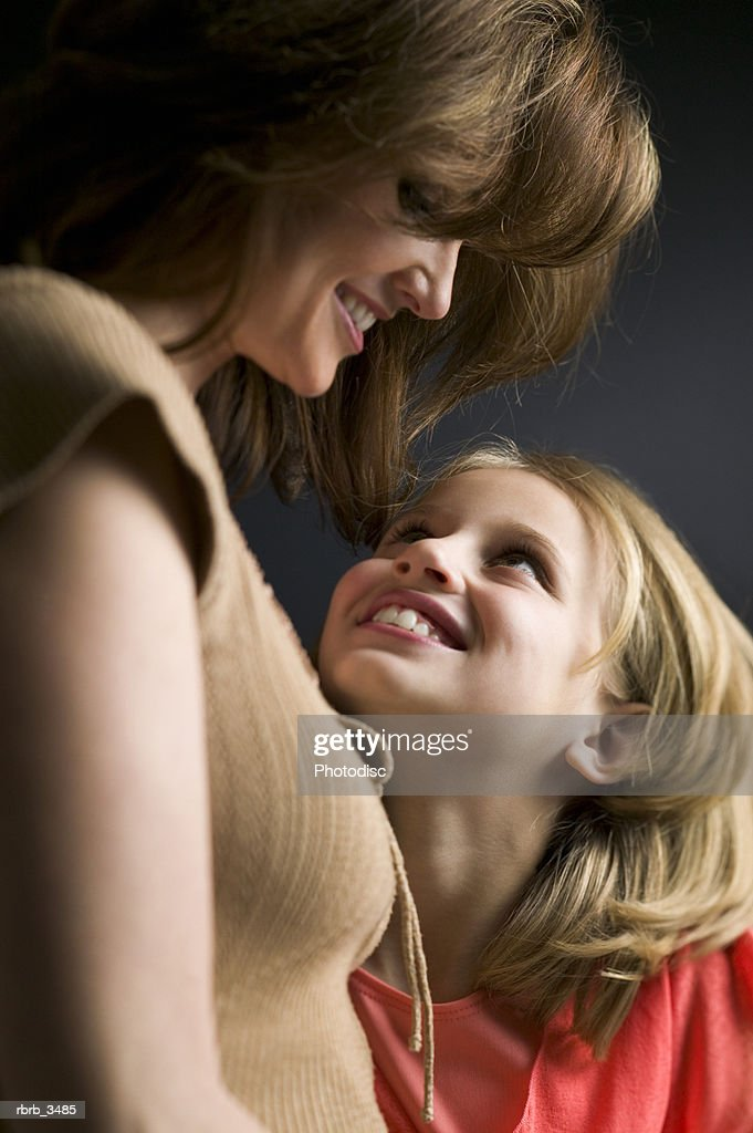 Mother and daughter smiling : Foto de stock