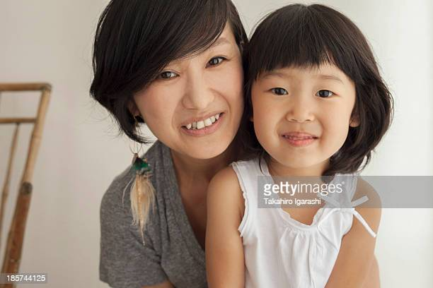 Mother and daughter smiling,  portrait