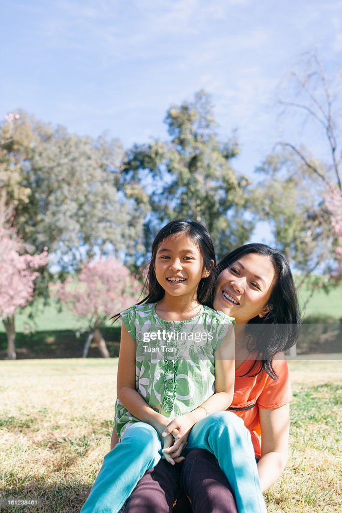 Mother and daughter smiling togher at the park : Stock Photo