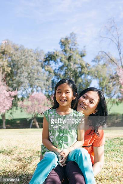 Mother and daughter smiling togher at the park