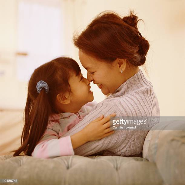 mother and daughter (7 years) snuggling - 30 39 years ストックフォトと画像