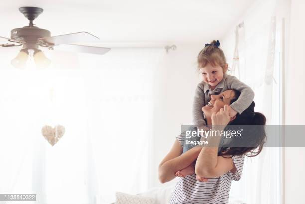 mother and daughter spending a week-end morning together - rite of passage stock pictures, royalty-free photos & images