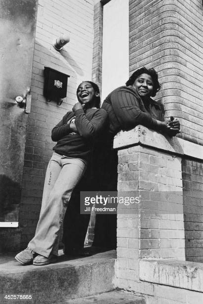 A mother and daughter stand on the steps of an apartment in Washington DC 1977