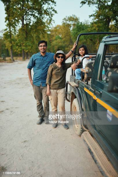 mother and daughter standing by the wildlife safari vehicle - bandhavgarh national park stock pictures, royalty-free photos & images