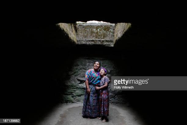 mother and daughter standing under skylight - guatemala fotografías e imágenes de stock