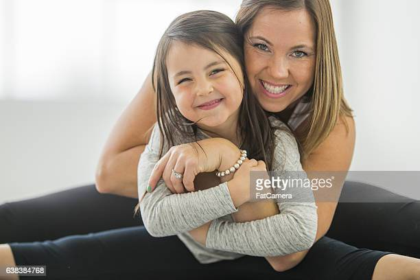 Mother and Daughter Stretching at Yoga