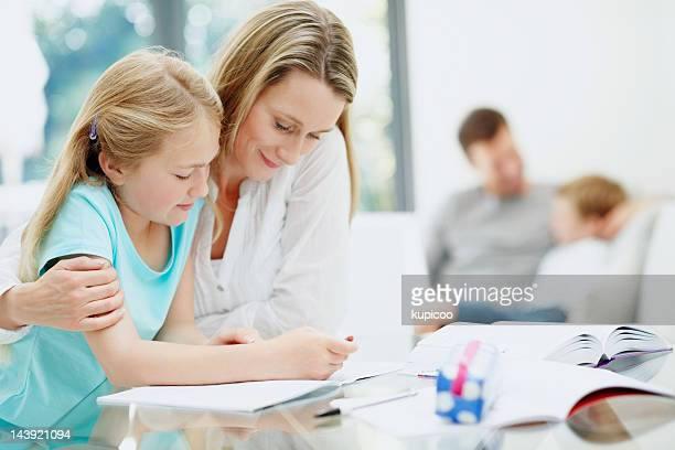Mother and daughter studying at home