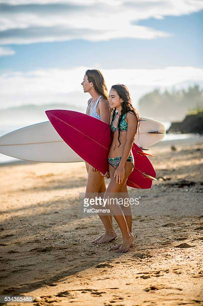 Mother and daughter surfers