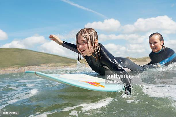 mother and daughter surfing - escaping stock pictures, royalty-free photos & images