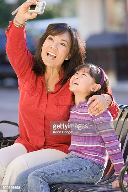Mother and Daughter Taking a Photograph of Themselves