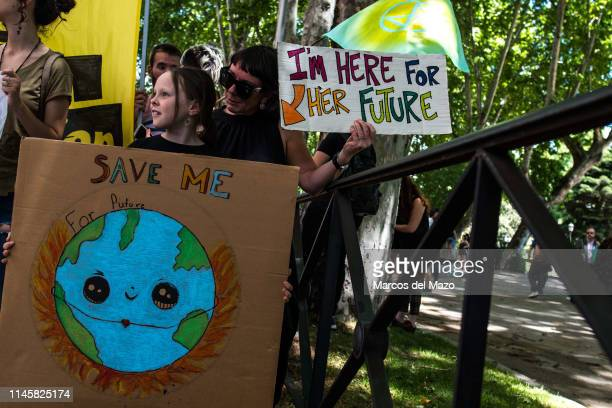 Mother and daughter taking part in a demonstration against climate change Environmental activists of movement 'Fridays for Future' are protesting...