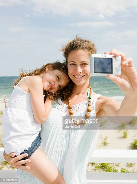 Mother and Daughter taking Self Portrait at Beach
