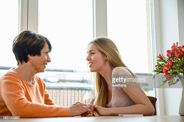Mother and daughter talking face to face
