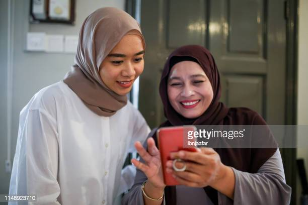 mother and daughter talking - eid ul fitr photos stock pictures, royalty-free photos & images