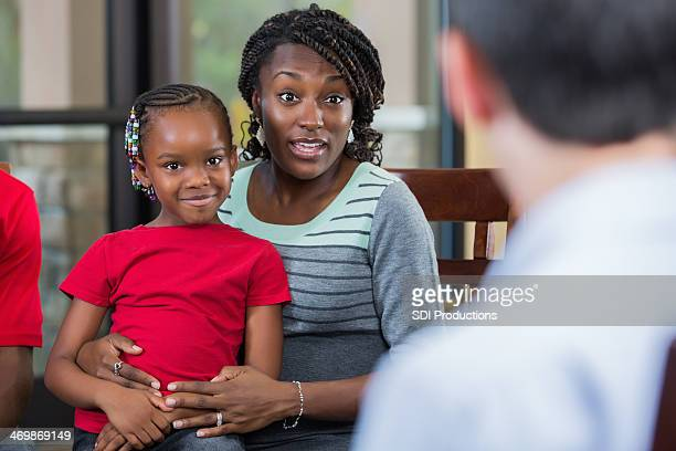Mother and daughter talking with counselor during family counseling session