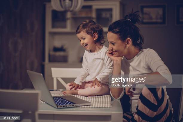 mother and daughter team - cartoon stock photos and pictures