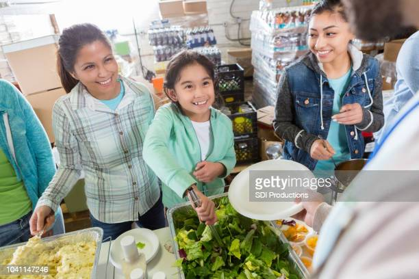 Mother and daughter team serve at soup kitchen