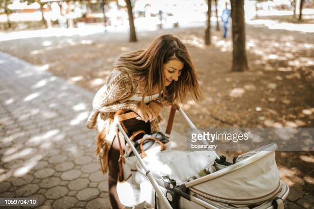 mother and daughter time - baby stroller stock pictures, royalty-free photos & images