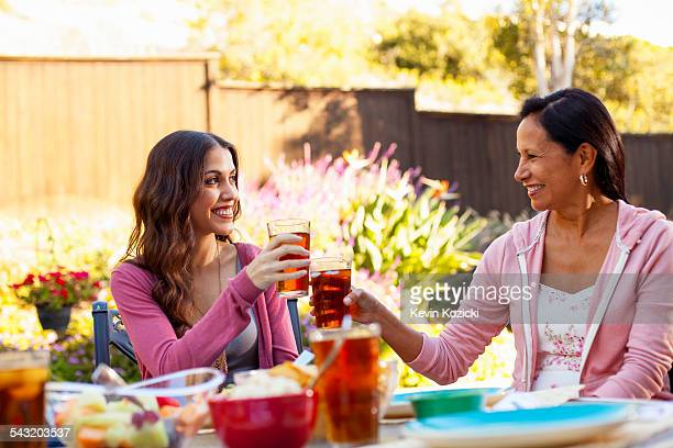 mother and daughter toasting in garden - rancho palos verdes stock pictures, royalty-free photos & images