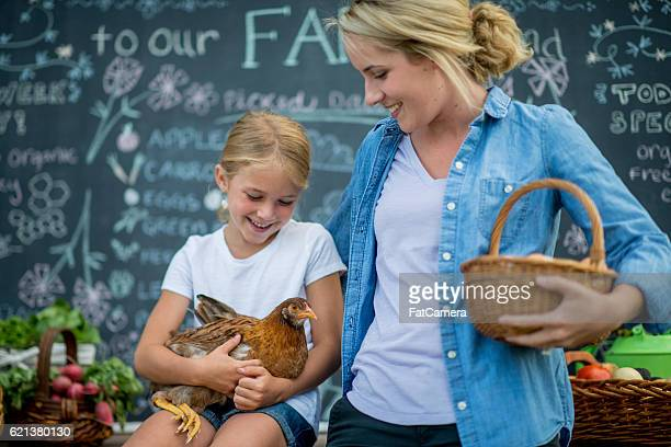 mother and daughter together at the market - farm to table stock photos and pictures