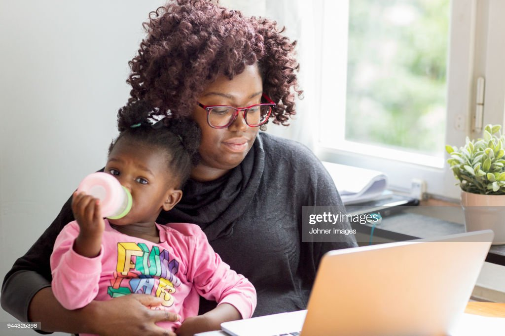Mother and daughter together : Stock Photo