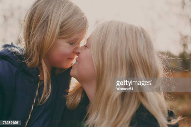 mother and daughter touching noses - long nose stock photos and pictures