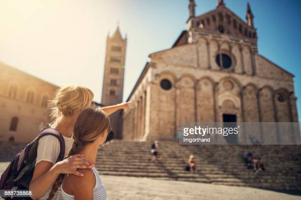 mother and daughter tourists sightseeing town of massa marittima in tuscany, italy - tourism stock pictures, royalty-free photos & images