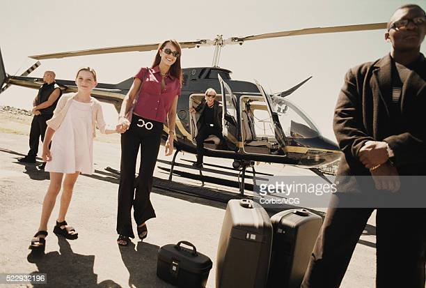 mother and daughter travelling by helicopter - helicopter stock pictures, royalty-free photos & images