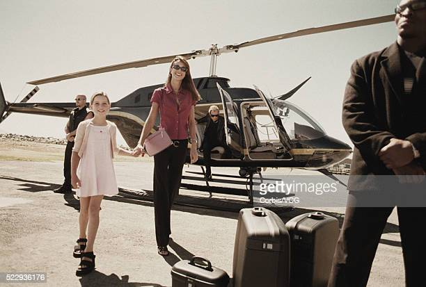 Mother and Daughter Travelling by Helicopter