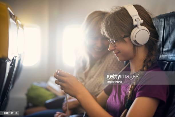 Mother and daughter travelling by plane