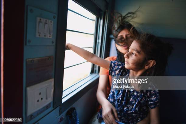 Mother and daughter travelling by train