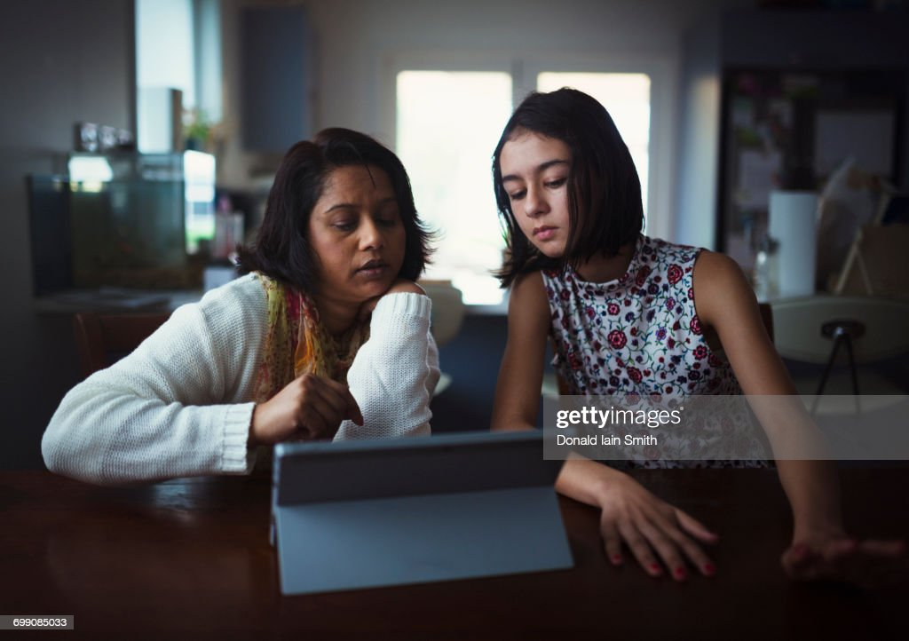Mother and daughter using digital tablet : Stock Photo