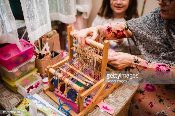 mother and daughter using loom - västra götaland county stock pictures, royalty-free photos & images