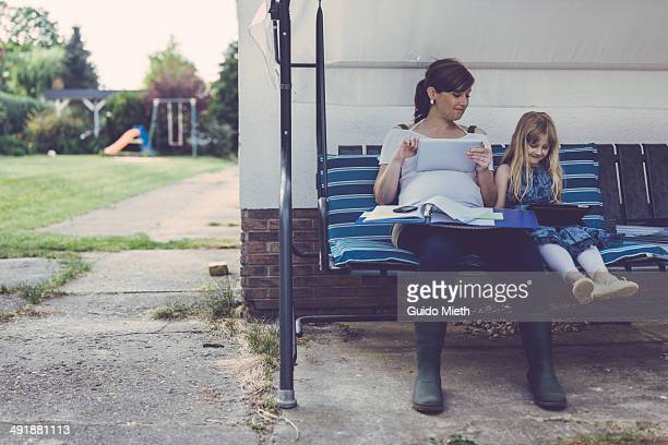 Mother and daughter using mobile device.
