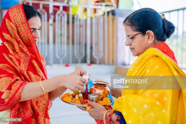 mother and daughter visiting a temple - shiva stock pictures, royalty-free photos & images
