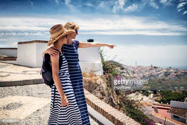 mother and daughter visiting white village in andalusia, spain - andalucia stock pictures, royalty-free photos & images