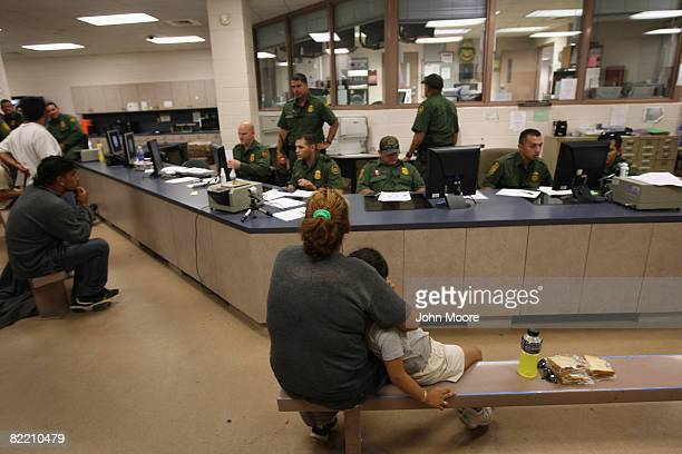 A mother and daughter wait for outprocessing at a US Border Patrol station after they were caught crossing from Mexico into the United States August...