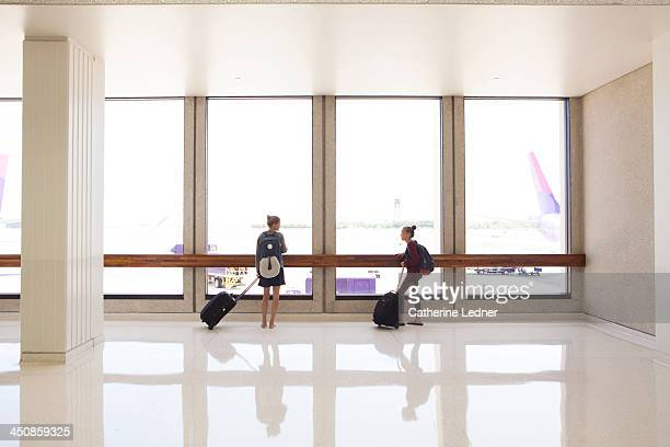 Mother and Daughter waiting at airport terminal