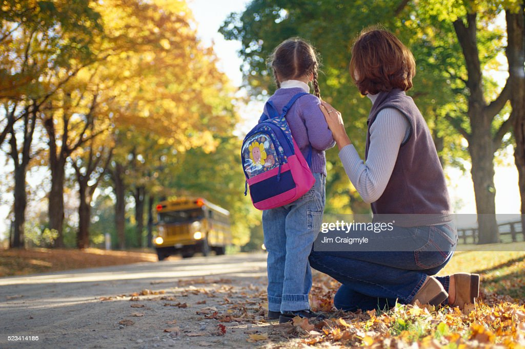 Mother and Daughter Waiting for School Bus : Stock Photo