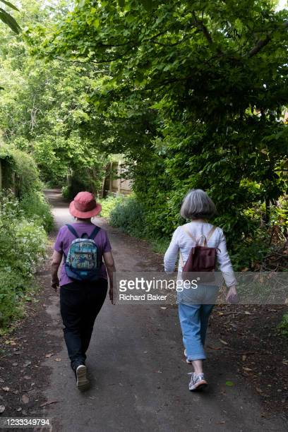 Mother and daughter walk along a country lane, on 30th May 2021, in Nailsea, North Somerset, England.