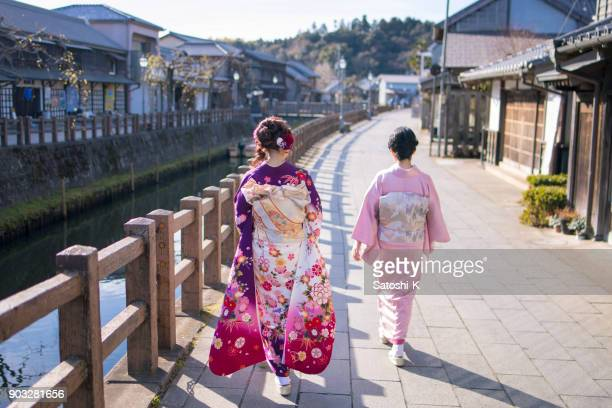 mother and daughter walking along river on coming of age day - seijin no hi stock pictures, royalty-free photos & images