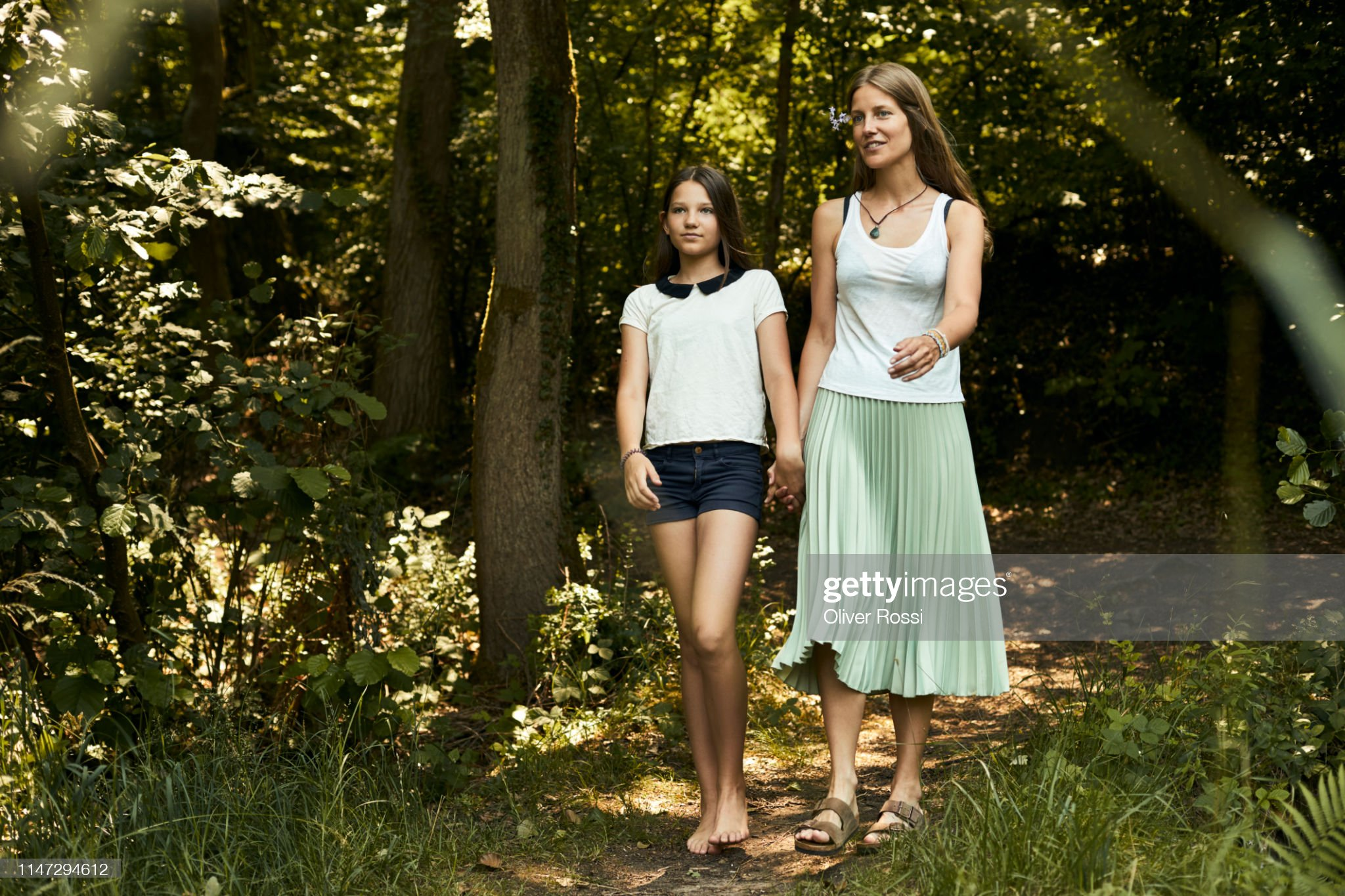 https://media.gettyimages.com/photos/mother-and-daughter-walking-hand-in-hand-on-a-forest-path-picture-id1147294612?s=2048x2048