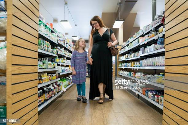 Mother and daughter walking in nutrition store