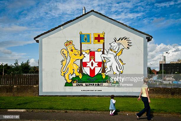 Mother and daughter walking in Shankill, Loyal quarter of Belfast West, Northern Ireland