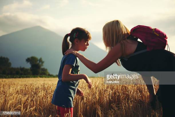 mother and daughter walking in the fields - ivanjekic stock pictures, royalty-free photos & images