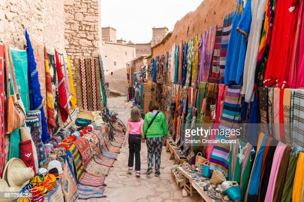 Mother and daughter walking on streets of Ait Benhaddou fortress
