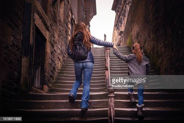 mother and daughter walking up steps in edinburgh, scotland - scotland stock pictures, royalty-free photos & images