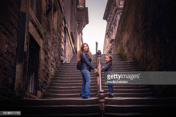 Mother and daughter walking up steps in Edinburgh, Scotland