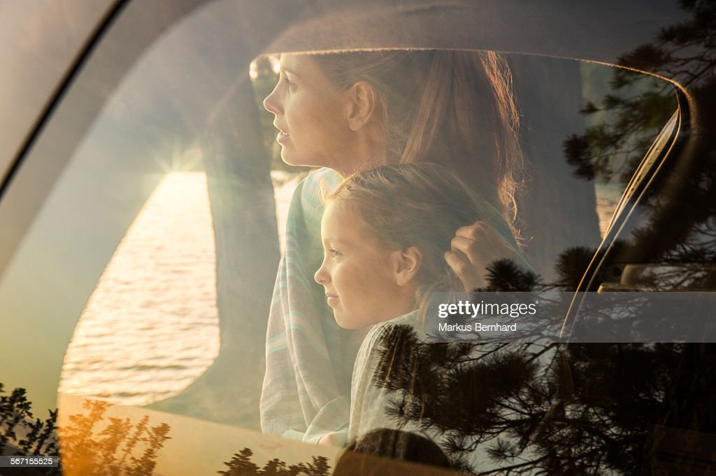 Mother and daughter watching sunset. : Stock Photo