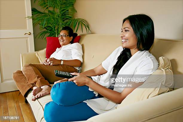 Mother and daughter watching television together